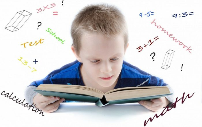 young boy learning math